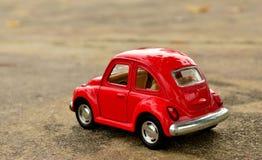 Coche rojo del juguete Imagenes de archivo