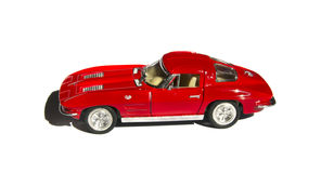 Coche rojo del juguete aislado en el fondo blanco Imagen de archivo libre de regalías
