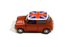 Coche rojo del juguete con el indicador británico Imágenes de archivo libres de regalías