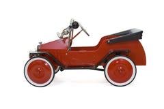 Coche rojo del juguete de la vendimia - aislado Imágenes de archivo libres de regalías