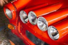 Coche rojo del subcompact de cuatro luces imagen de archivo libre de regalías
