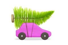 Coche rosado del juguete con el árbol de navidad verde imágenes de archivo libres de regalías