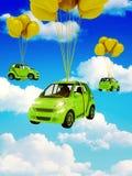 Coche verde con los globos amarillos Foto de archivo libre de regalías
