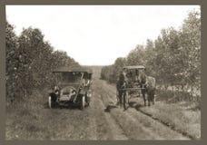 Coche y caballos antiguos de la fotografía Imagen de archivo libre de regalías