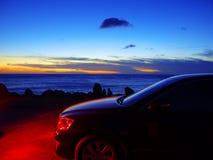 Coche y puesta del sol Fotografía de archivo libre de regalías