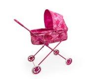 Cochecito de niño rosado del juguete Fotos de archivo