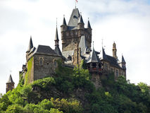 Cochem Imperial castle in Germany. COCHEM, GERMANY - AUGUST 14, 2014: Cochem Imperial castle on green hill in Germany. The Reichsburg Cochem had its first royalty free stock photography