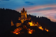Cochem Imperial Castle on mountain at night Royalty Free Stock Images