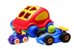 Coches coloridos del juguete de Childs con el fondo blanco Imagen de archivo libre de regalías
