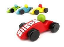 Coches de carreras de madera de los juguetes fotos de archivo