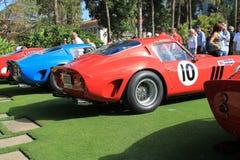 Coches de carreras del gto de Ferrari alineados Foto de archivo libre de regalías