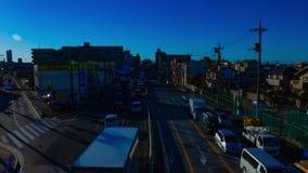 Coches de precipitaci?n en la calle c?ntrica en tiro ancho del timelapse diurno de Tokio almacen de metraje de vídeo