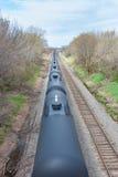 Coches del tanque negros en el movimiento Foto de archivo