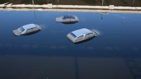 Coches en agua inundada Foto de archivo libre de regalías