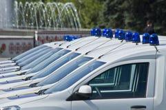 Coches policía con las sirenas rojas y azules del color Foto de archivo libre de regalías