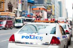 Coches policía en la 42.a calle Fotografía de archivo