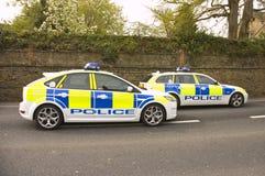 Coches policía en la escena Imagen de archivo libre de regalías