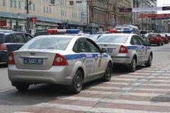 Coches policía en las calles de Moscú Foto de archivo libre de regalías