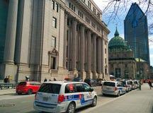Coches policía parqueados Fotografía de archivo