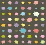 Cochinillos coloridos divertidos contra un fondo oscuro Imágenes de archivo libres de regalías