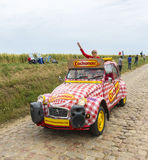 Cochonou Caravan on a Cobblestone Road- Tour de France 2015. Quievy,France - July 07, 2015: Cochonou Caravan during the passing of the Publicity Caravan on a Royalty Free Stock Image