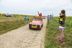 Cochonou Caravan on a Cobblestone Road- Tour de France 2015. Quievy,France - July 07, 2015: Cochonou Caravan during the passing of the Publicity Caravan on a Stock Photos
