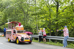 Cochonou Vehicle- Tour de France 2014. Le Markstein, France- July 13, 2014: Cochonou vehicle during the passing of the Publicity Caravan in front of excited Royalty Free Stock Photo