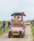 Cochonou-Wohnwagen auf einem Kopfstein-Straßen-Tour de France 2015 Lizenzfreies Stockbild