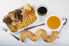Cocido a Spanish stew with assortment of meat and chikpeas stock photo