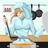 Cocina de la muchacha del cocinero Foto de archivo libre de regalías