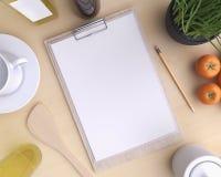 Cocina de marcado en caliente de la maqueta con la tabla y el artículos de cocina Fotos de archivo libres de regalías