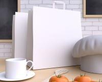 Cocina de marcado en caliente de la maqueta con la tabla y el artículos de cocina imágenes de archivo libres de regalías