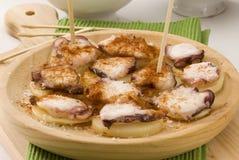 Cocina española. Estilo del gallego del pulpo. Imagen de archivo libre de regalías