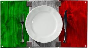 Cocina italiana - placa y cubiertos Imágenes de archivo libres de regalías