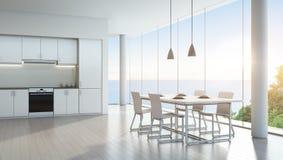 Cocina y comedor de la opinión del mar en casa de vacaciones de lujo con diseño interior blanco moderno Fotos de archivo