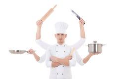 Cocinando el concepto - cocinero del hombre joven con 6 manos que sostienen equ de la cocina Foto de archivo