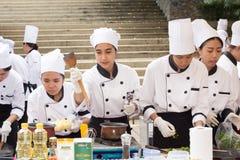 Cocinando la escuela de la competencia de los estudiantes de la gestión de negocio (cocinero menor del hierro) Imágenes de archivo libres de regalías