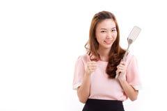 Cocinando a la mujer que da el pulgar para arriba Imágenes de archivo libres de regalías