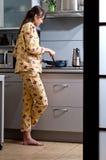 Cocinar el desayuno Imagen de archivo libre de regalías
