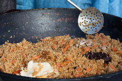 Cocinar el pilaf del Uzbek Fotografía de archivo libre de regalías