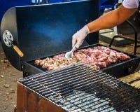 Cocinar la carne Fotografía de archivo
