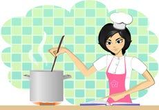 Cocinar a la mujer en sombrero del cocinero Fotos de archivo libres de regalías