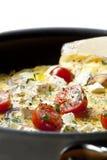 Cocinar la tortilla de huevos Foto de archivo