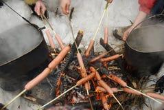 Cocinar las salchichas Imágenes de archivo libres de regalías