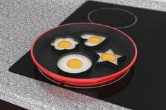Cocinar los huevos en estufa del cooktop de la inducción Foto de archivo