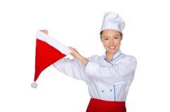 Cocinero asiático con el casquillo de Santa Claus Imagenes de archivo