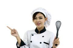 Cocinero asiático del cocinero de la mujer joven en blanco Fotos de archivo