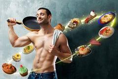 Cocinero atractivo que embroma Imagen de archivo libre de regalías