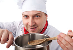 Cocinero con la cacerola Foto de archivo