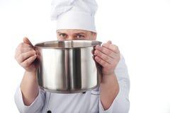 Cocinero con la cacerola Fotos de archivo libres de regalías